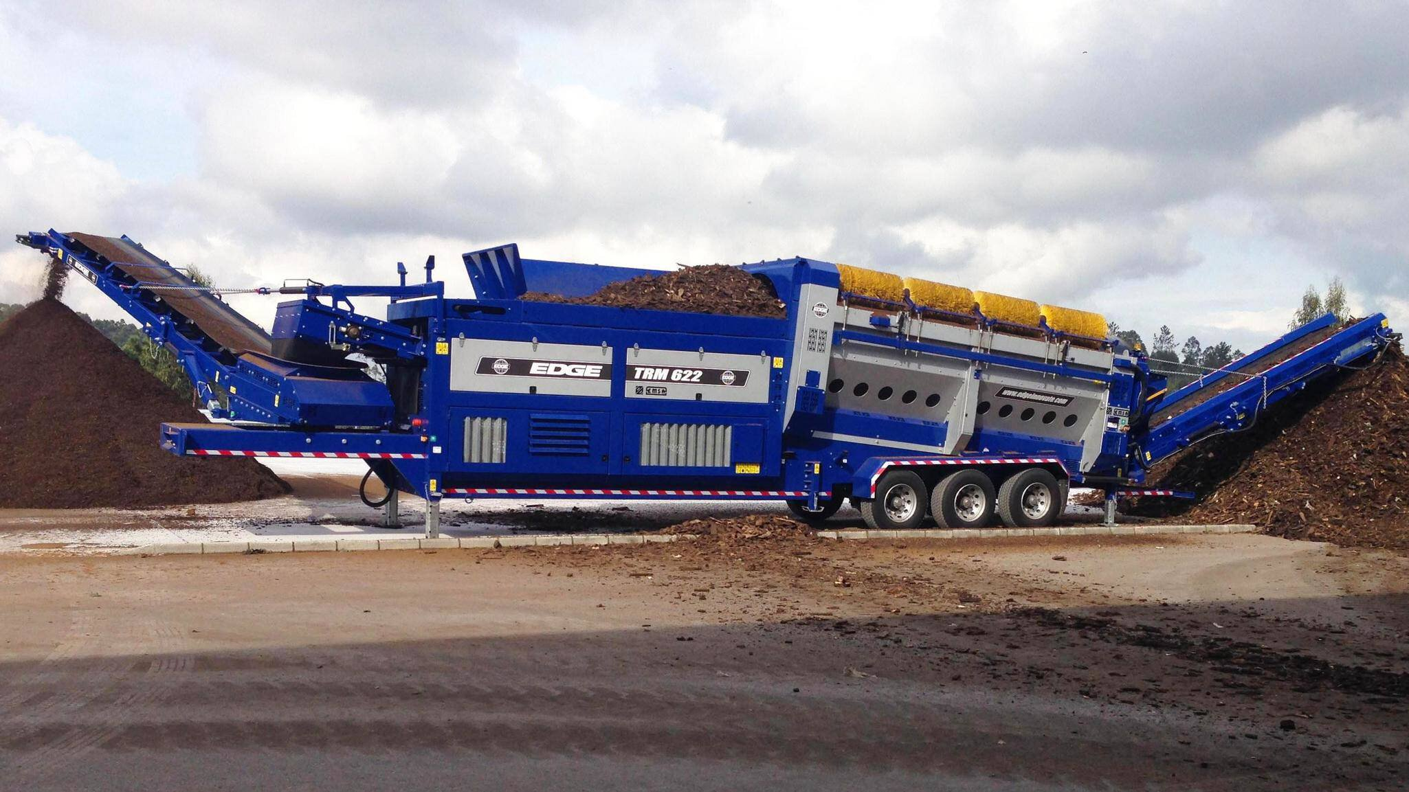 Gallery image 0 - The EDGE TR622 Trommel Range combines high production rates with ease of use in a robust, portable and versatile screening plant that is ideal for applications such as top soil, recycling, composting and is proven in construction and demolition waste.